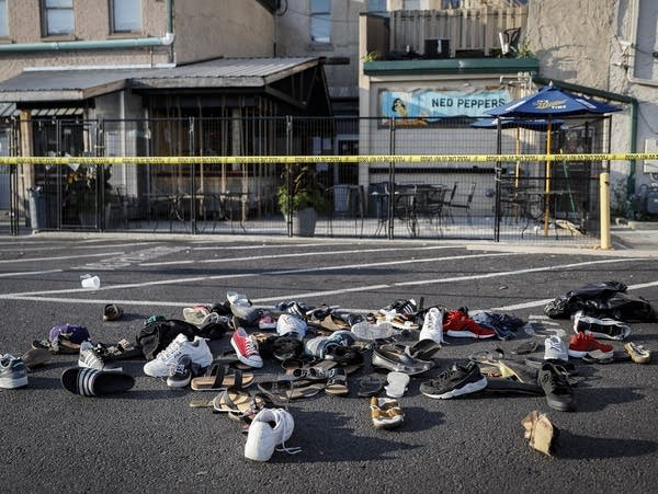 Shoes are piled at the scene of a mass shooting