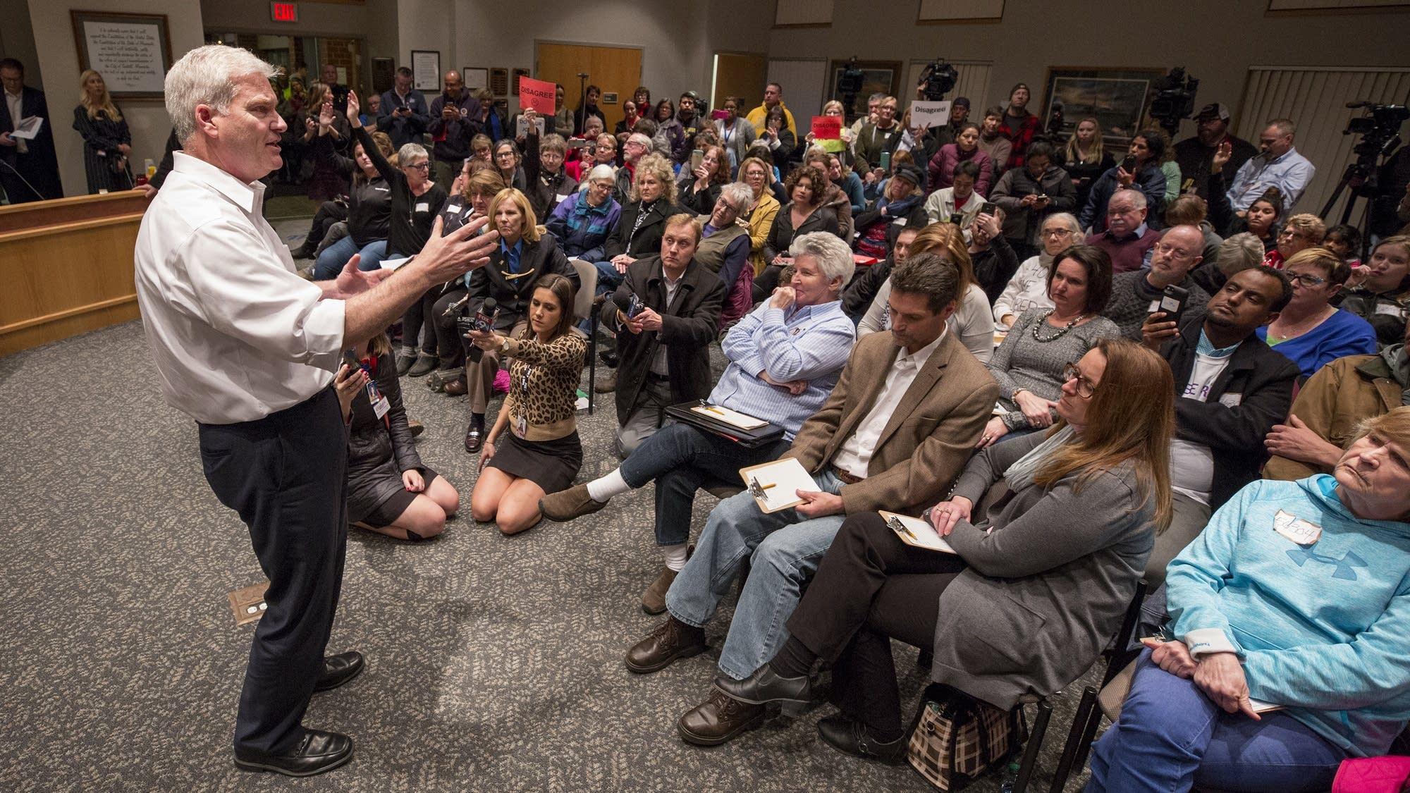Overflow crowd brings tough questions, civil debate to ...