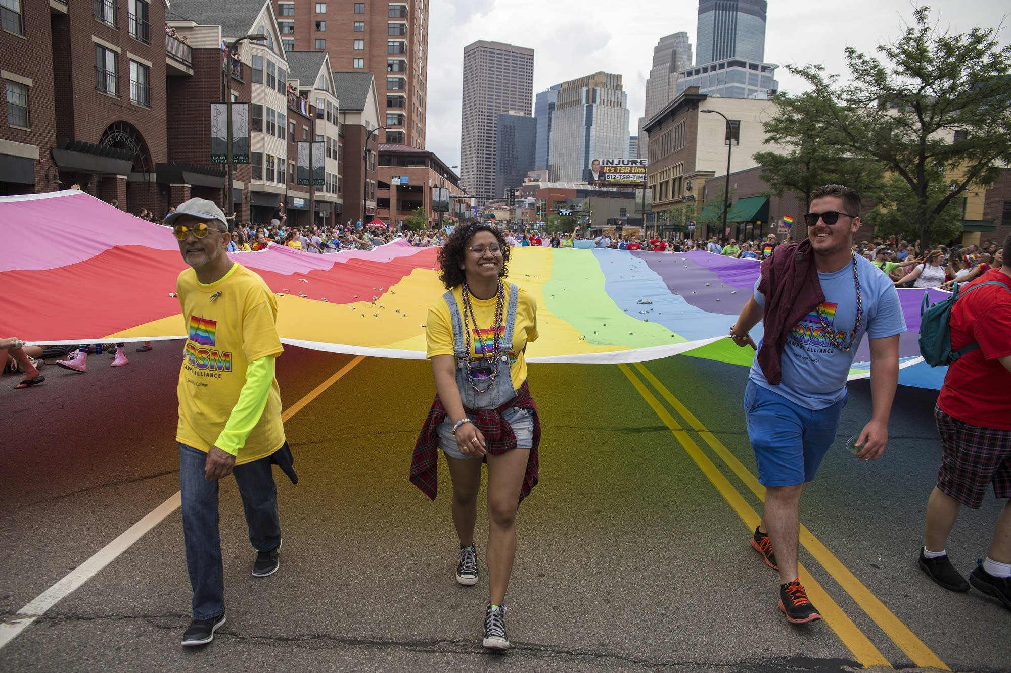 The Rainbow Flag is carried down Hennepin Avenue.