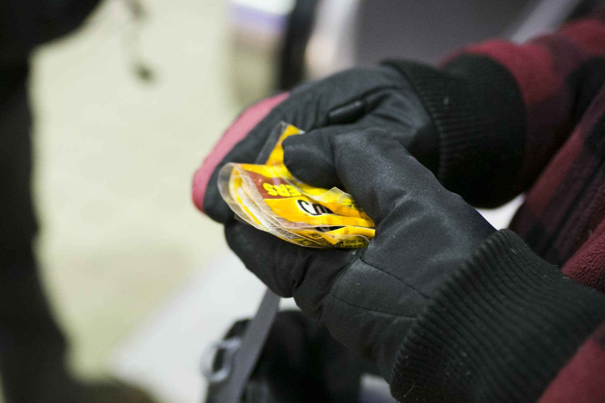 Gregory Graham holds packets of hand warmers