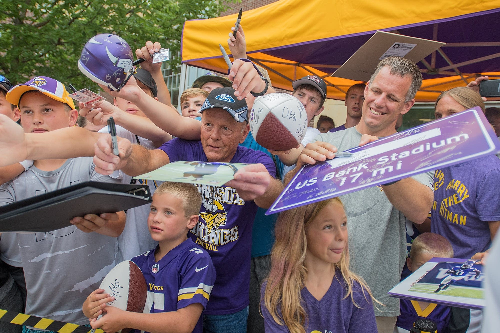 Fans clamor for autographs as veterans reported to training camp.