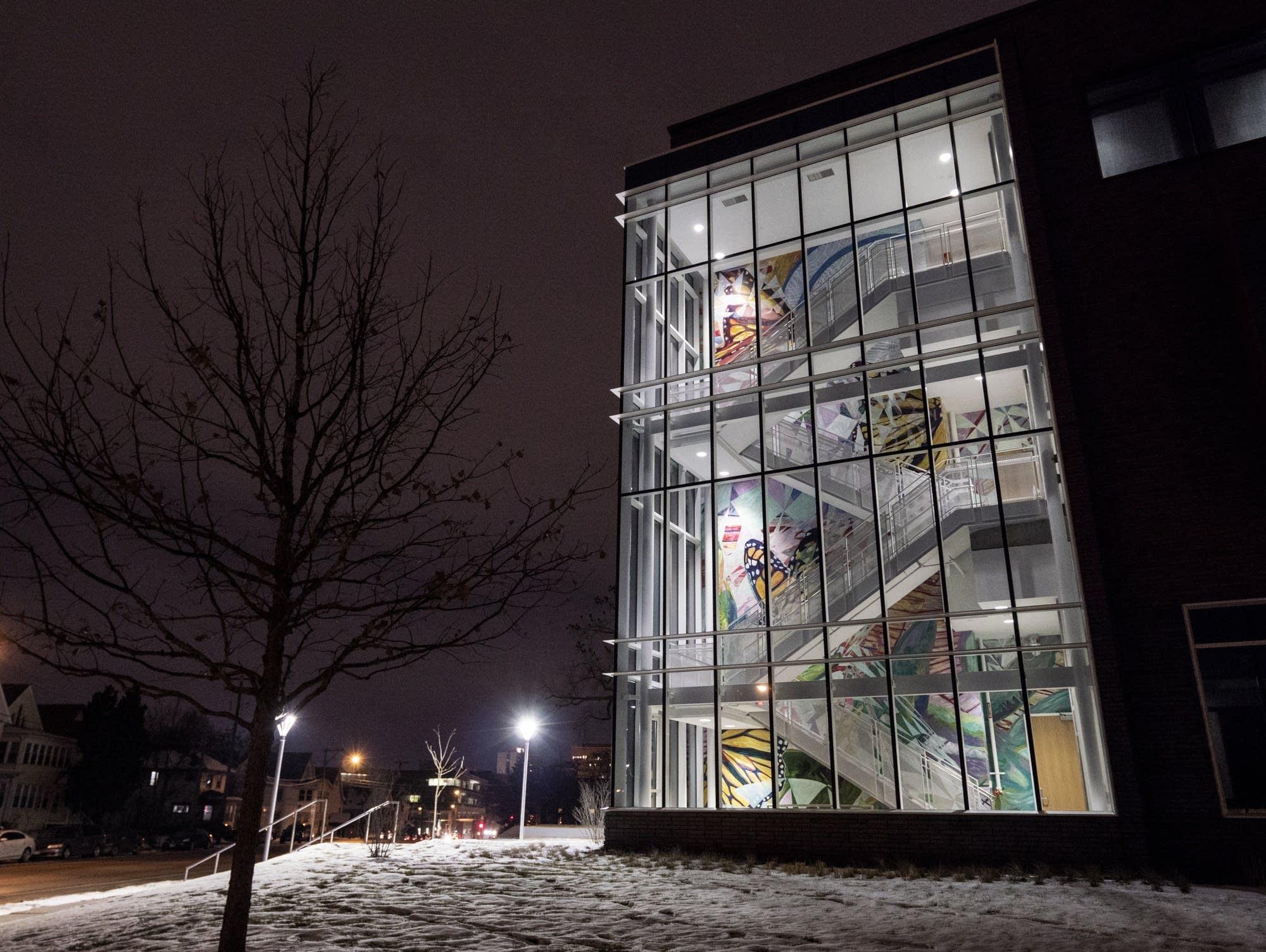 """Greta McLain's mural """"Emergence"""" fills Hagfors Center's stairwell."""