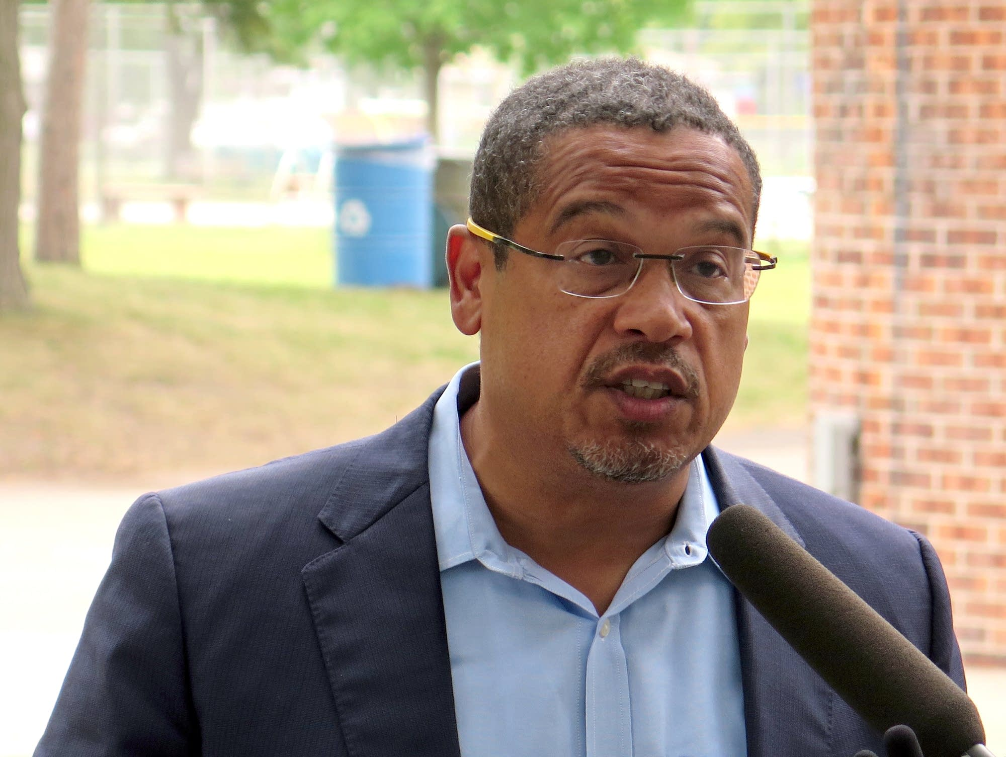 Keith Ellison takes questions from reporters.