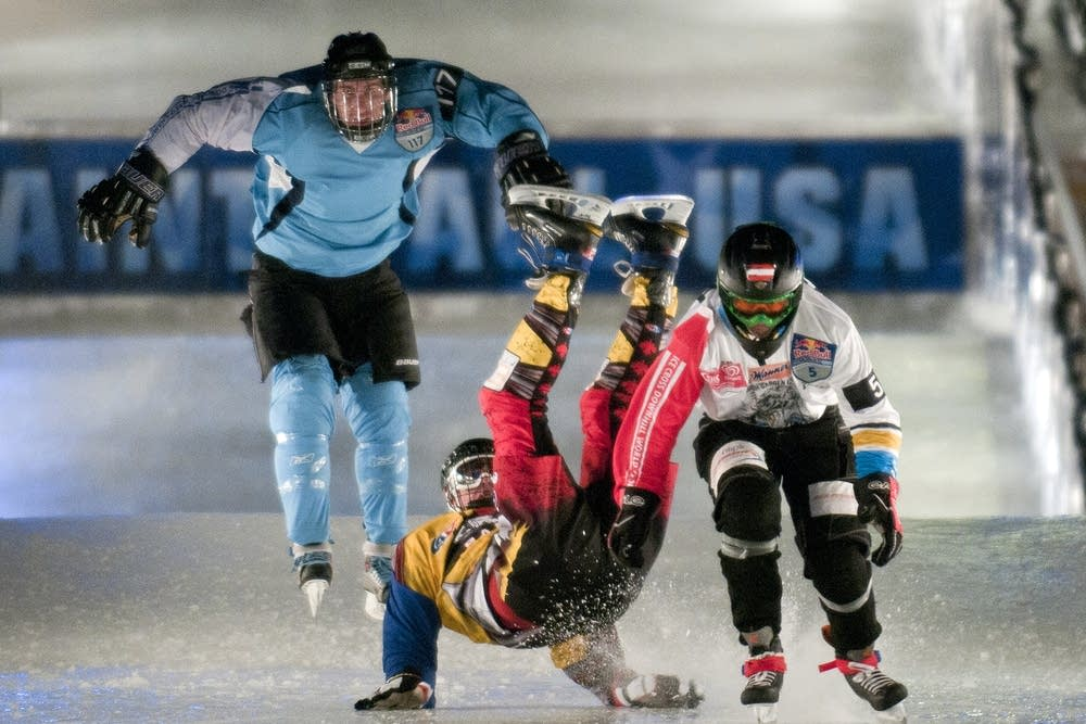 Daniel Guolla of Canada, center, braces for a fall