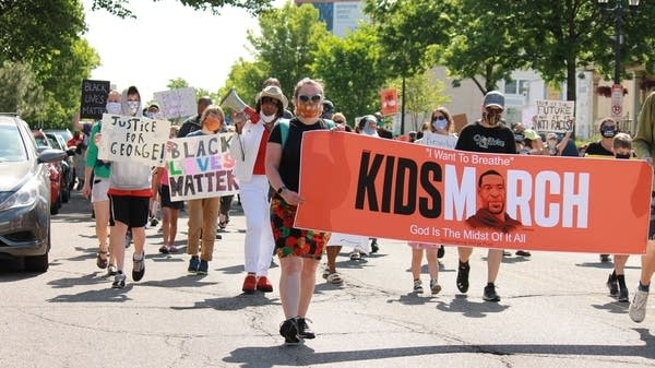 People take part in a march for kids and families