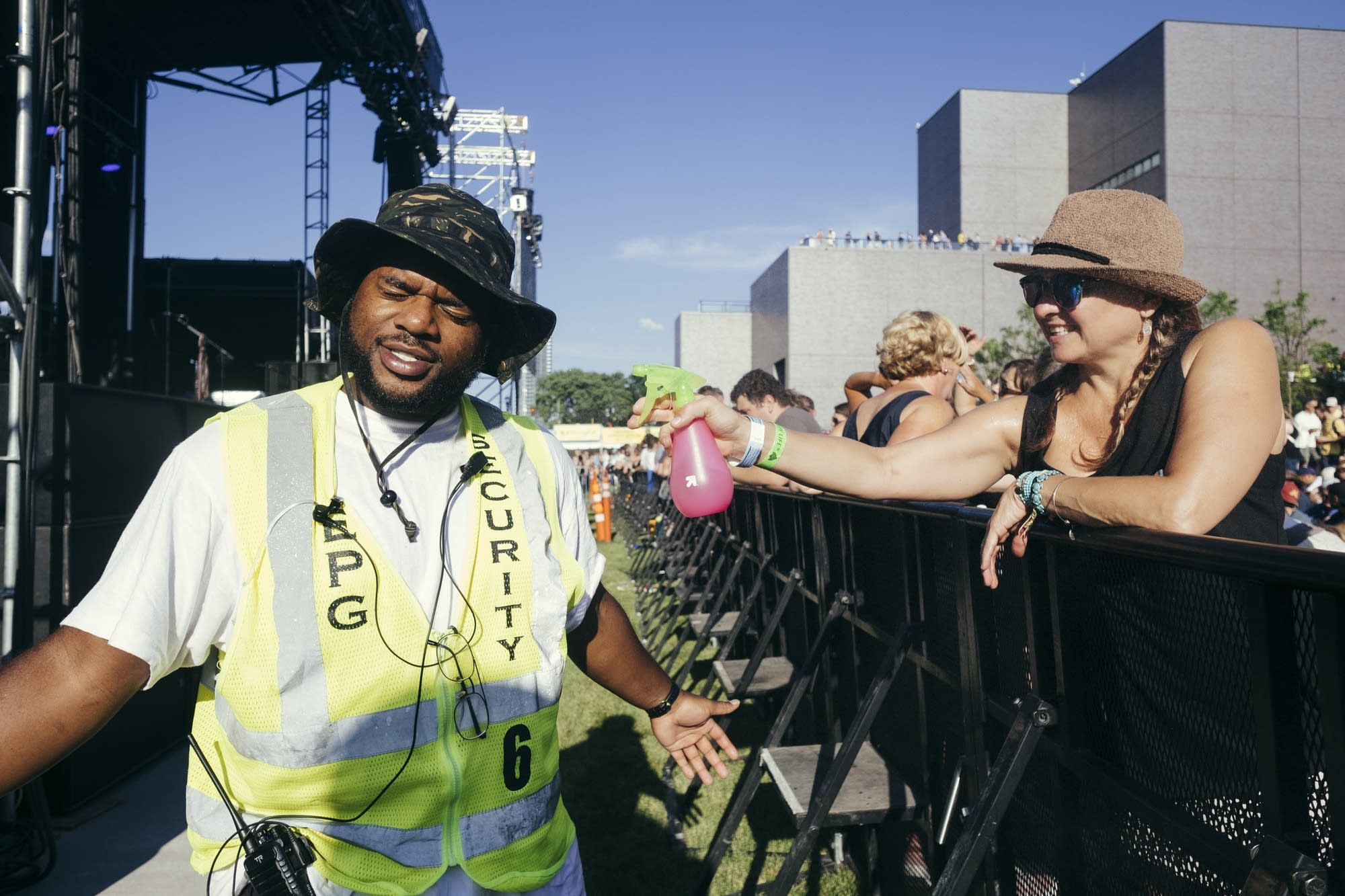 A fan helps a security guard cool off.
