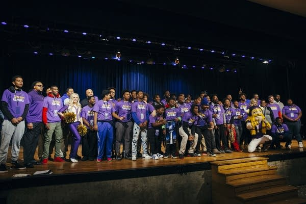 The Minneapolis North High School football team gets their picture taken.