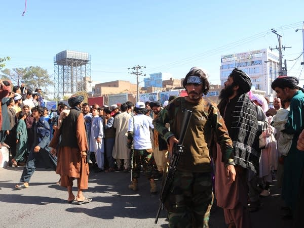 A crowd gathers in a city square in Afghanistan