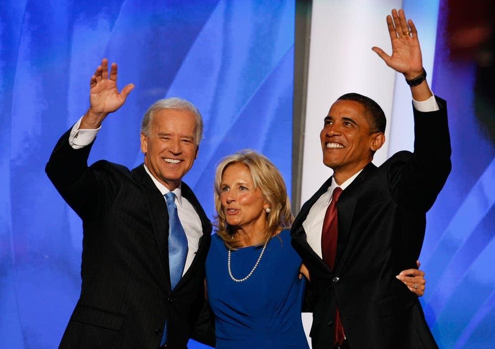 Barack Obama and Joe Biden wave to the crowd