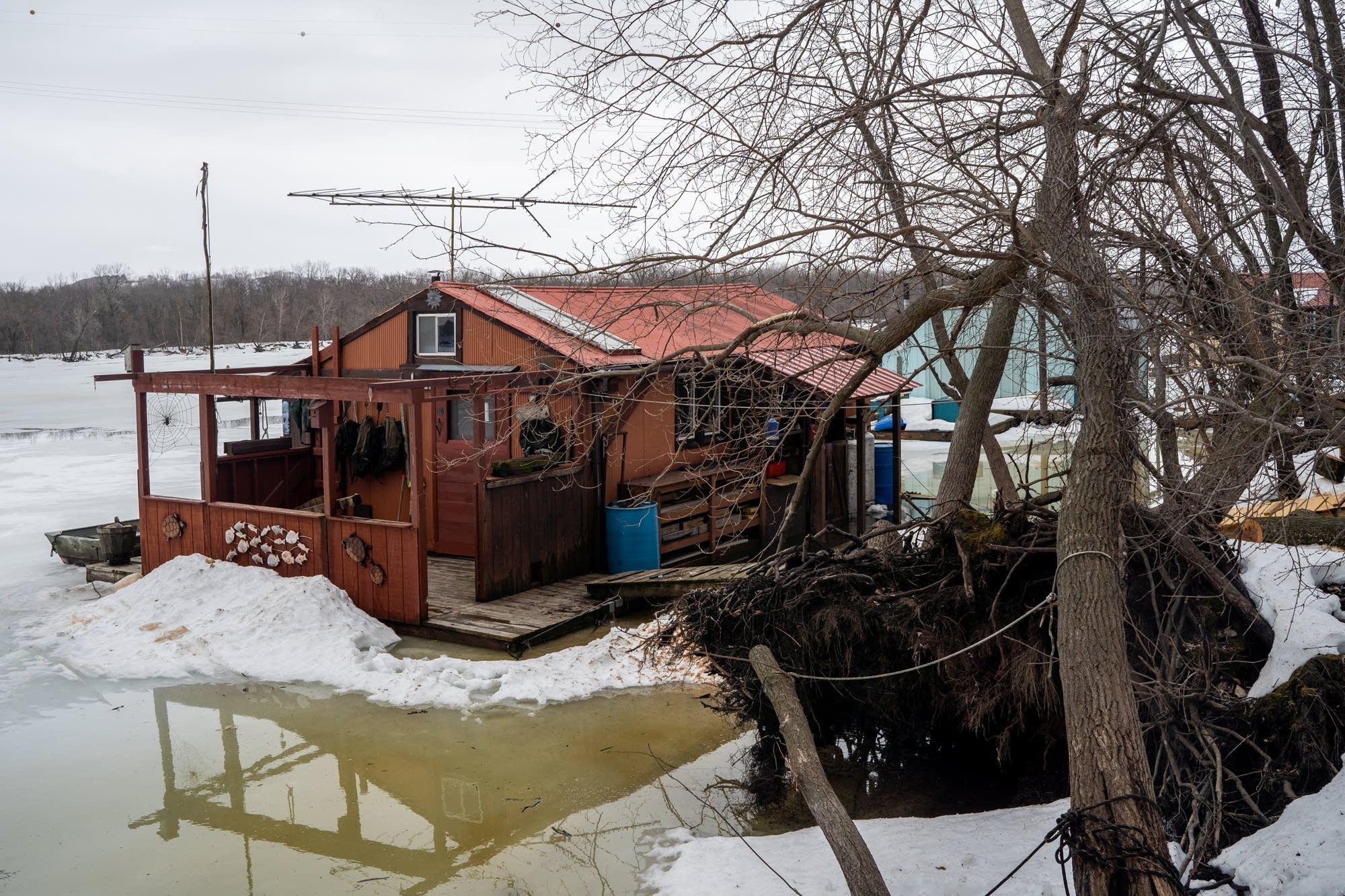 Ice and snow encase John Rupkey's home on Latsch Island.