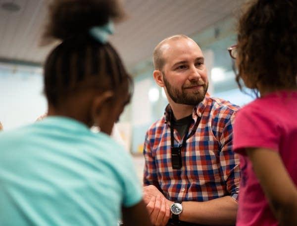 Kindergarten teacher Matt Proulx works with some of his students.