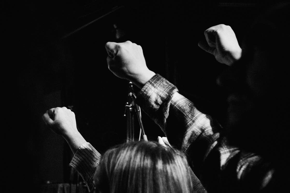 Fists raised before Pussy Riot at the Turf Club