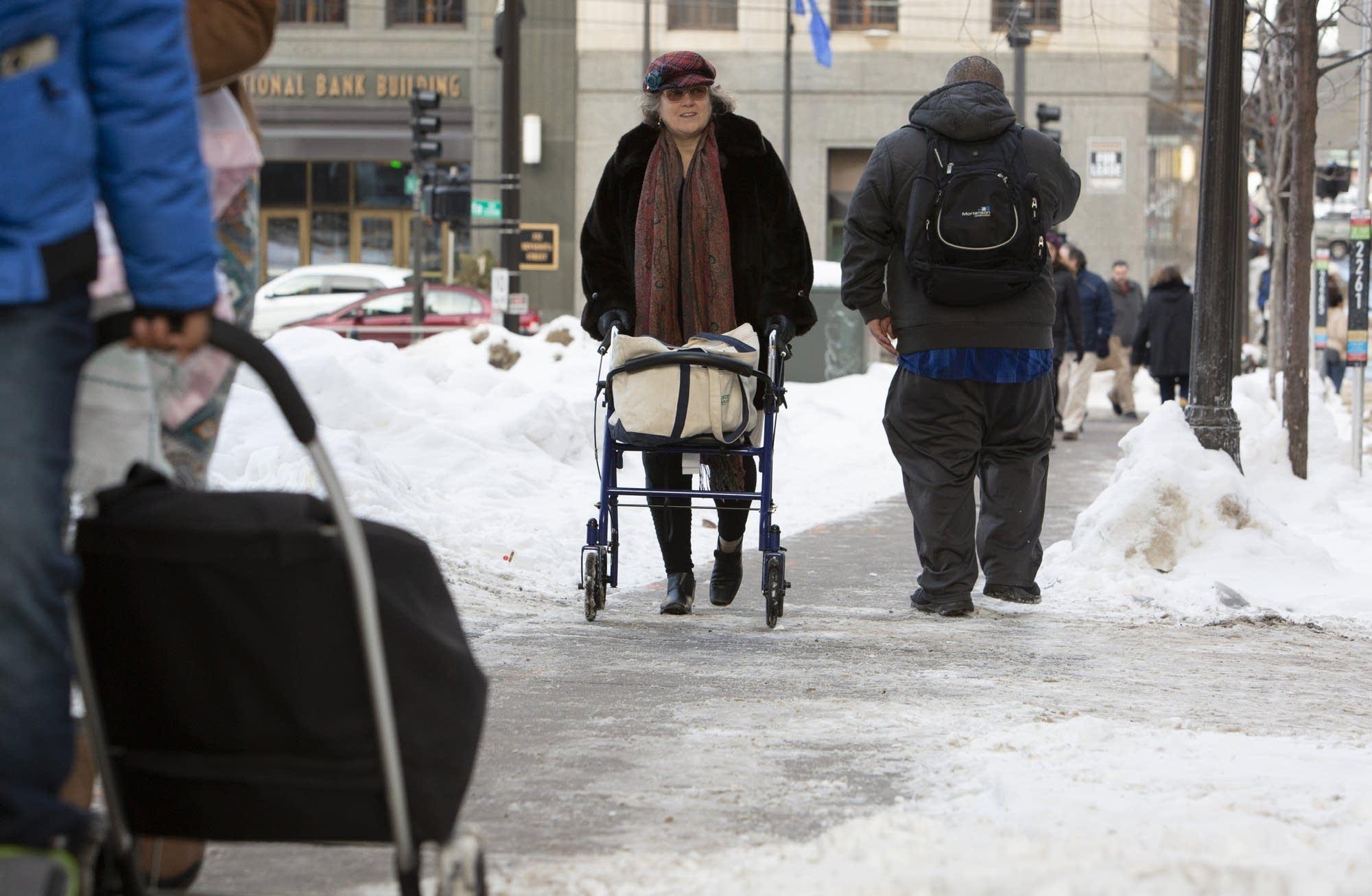Ava McKnight makes her way down the sidewalk near Central Station