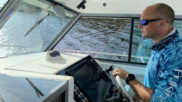 A person driving a boat.