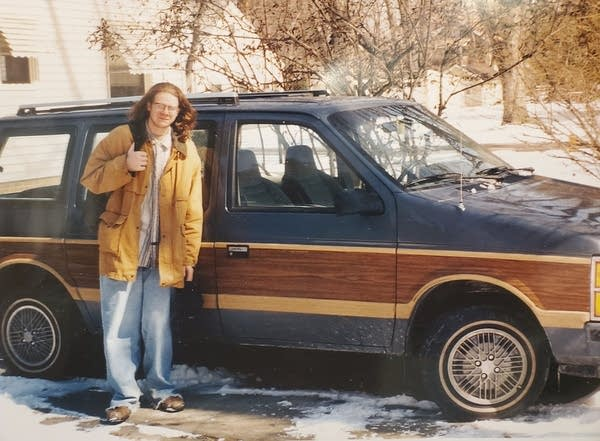 A young Andrew and his old minivan