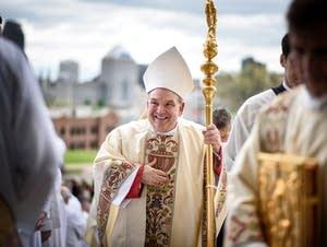 Archbishop Bernard Hebda greets priests, deacons