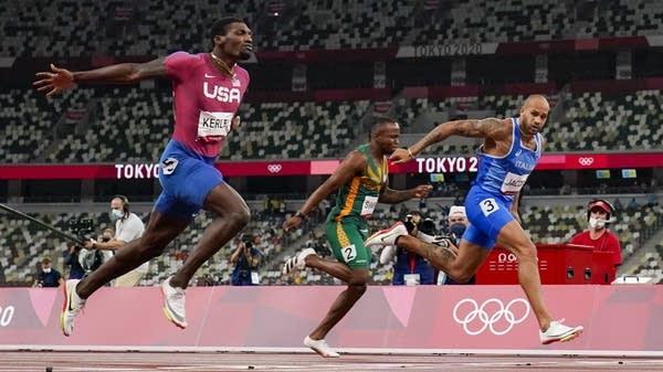 Runners finish a sprint race