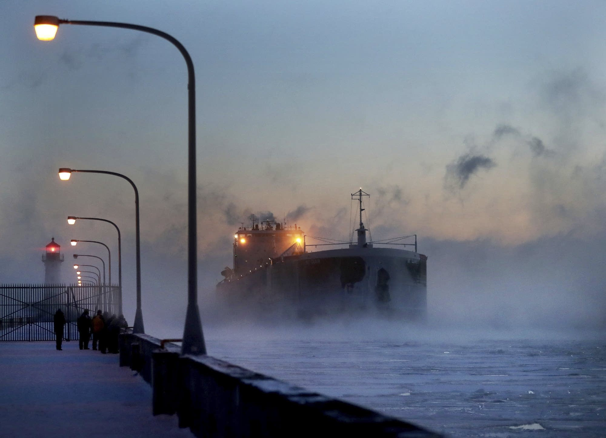 Steam rises from Lake Superior as the St. Clair comes to harbor Sunday.