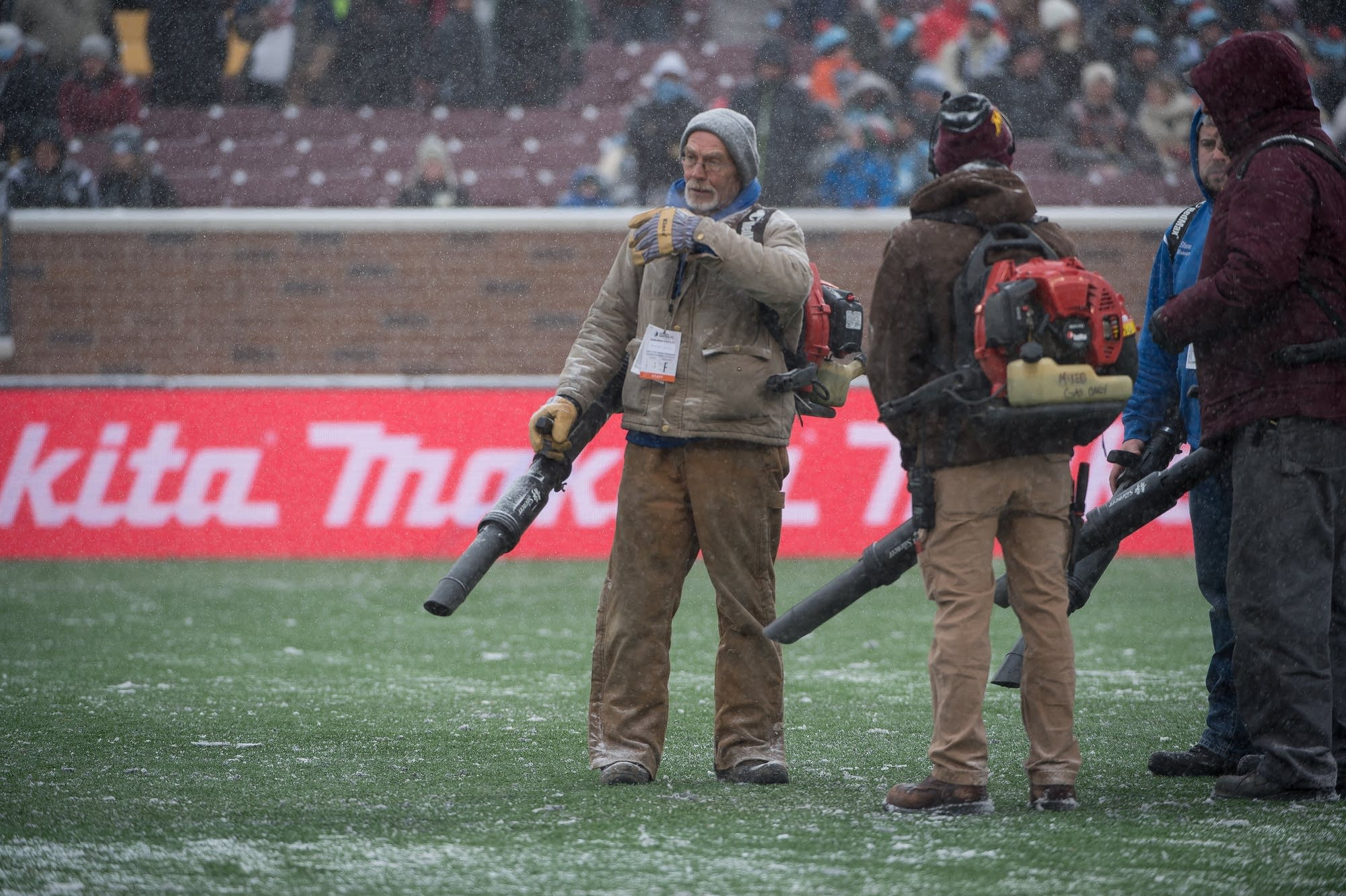 Leaf blowers were used to keep snow off the turf.