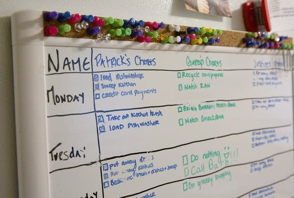 A dry erase board details daily chores.