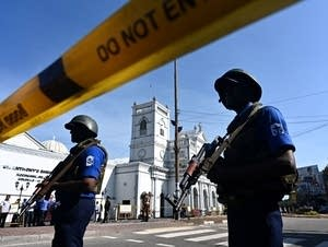 Security personnel stand guard outside St. Anthony's Shrine in Colombo.