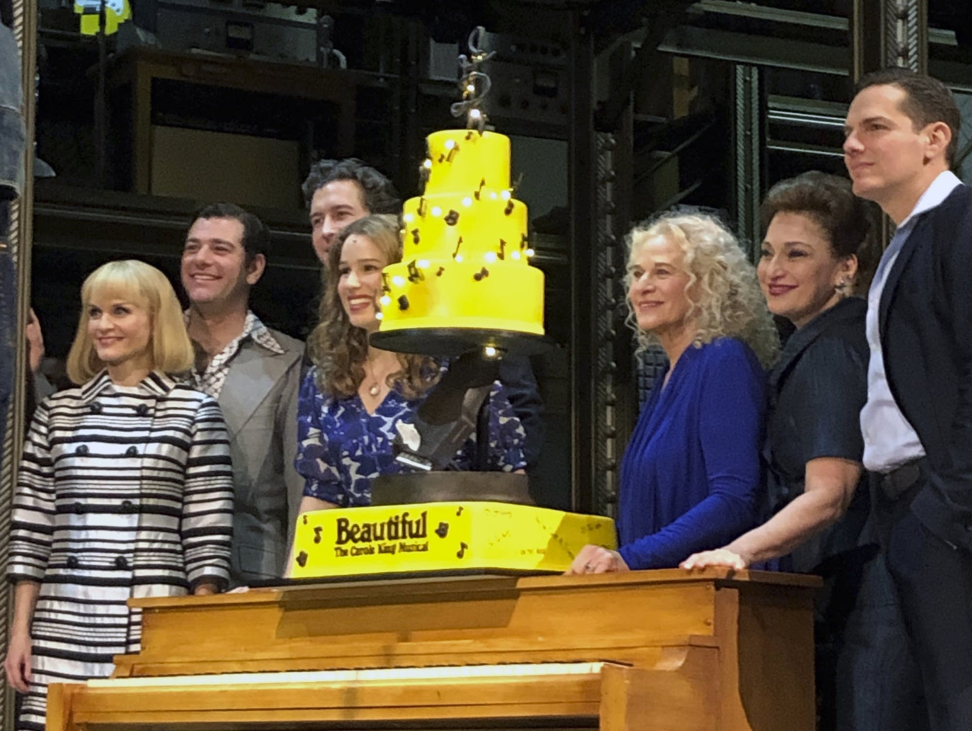 Carole King poses for photos with the cast of