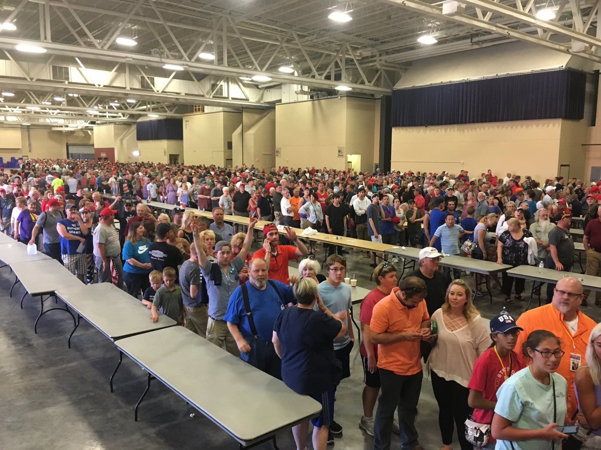 People stand in line trying to get into the President Trump rally.