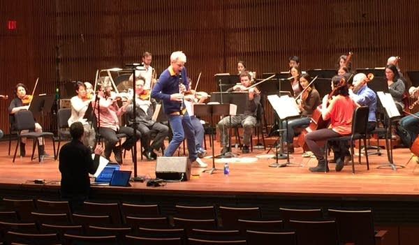 SPCO Artistic Partner Martin Fröst uses his hip to create a specific sound.
