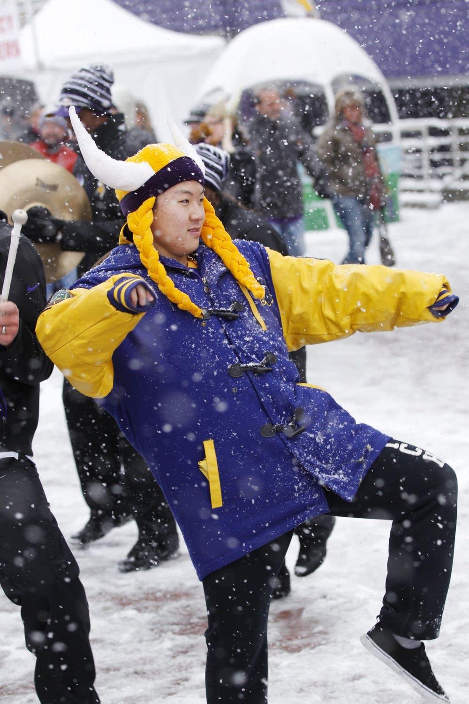 A Vikings fan dances in the snow