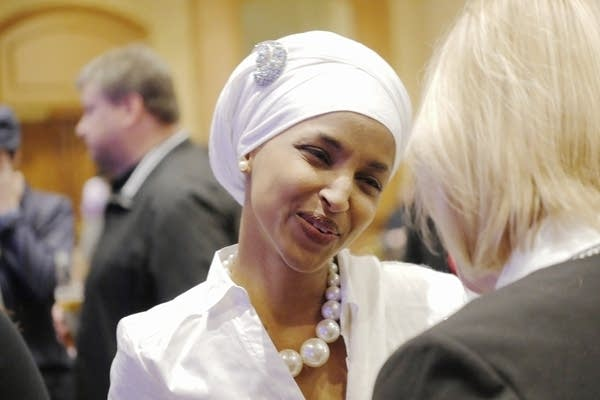 Ilhan Omar greets people at the DFL party.