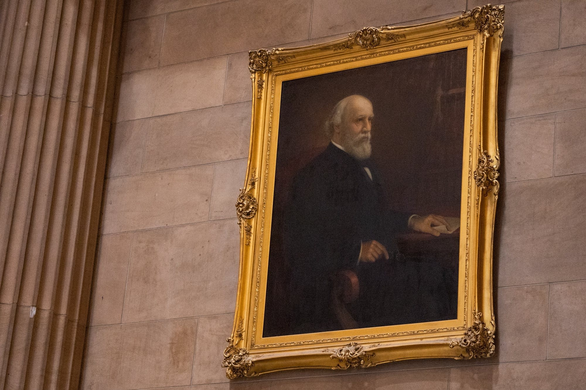 A portrait of James J. Hill hangs above the reading room.