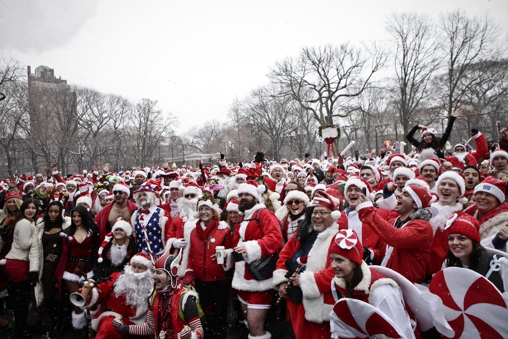 Revelers Dressed As Santa Take Part In Annual Bar