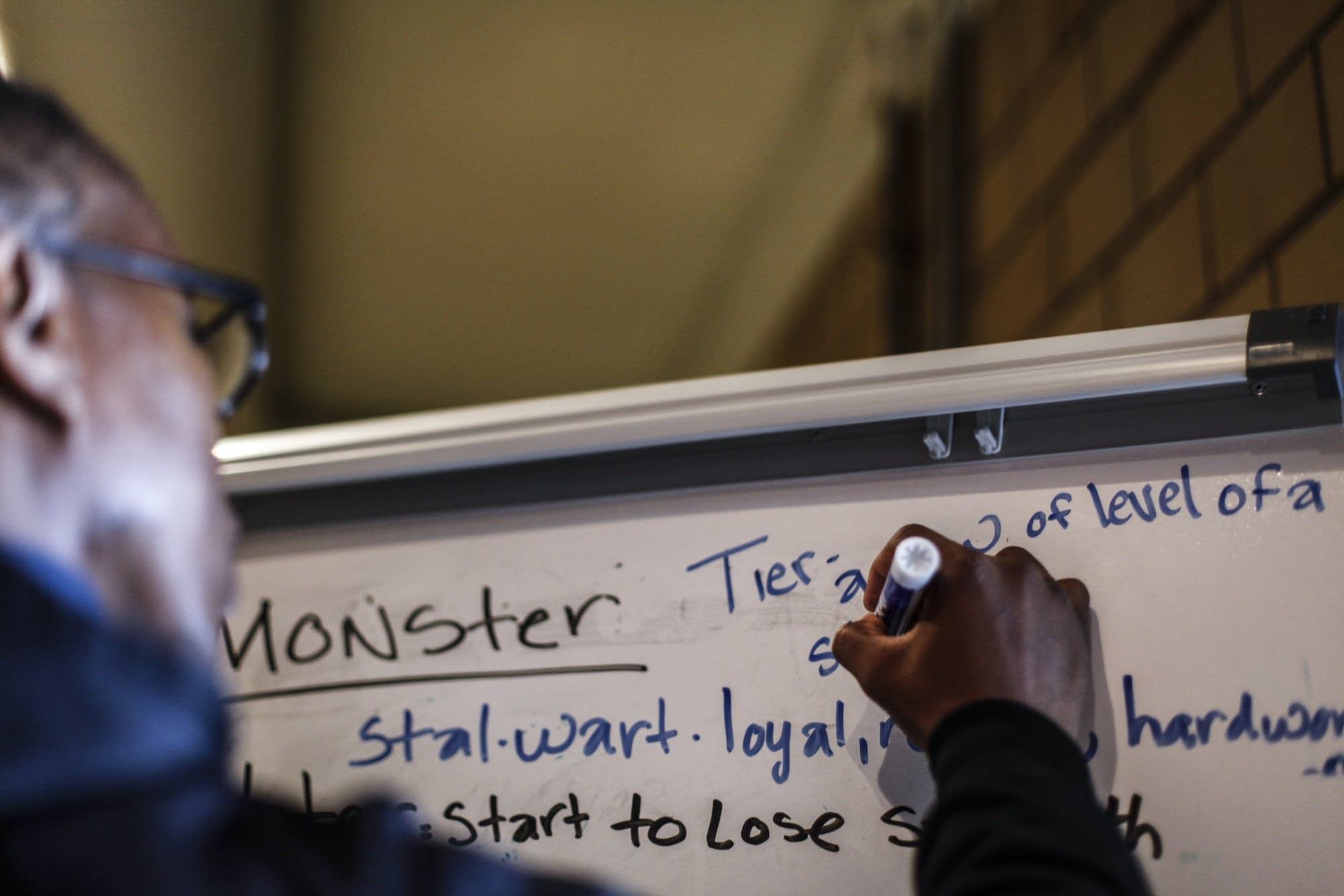 Morgan McDonald Sr. writes terms on a whiteboard.