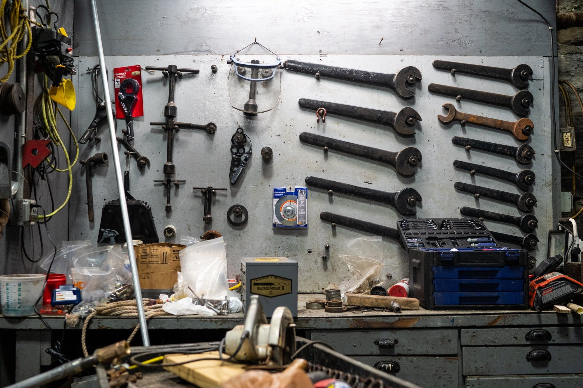 Wrenches and other tools used to maintain the turbines hang on the wall.