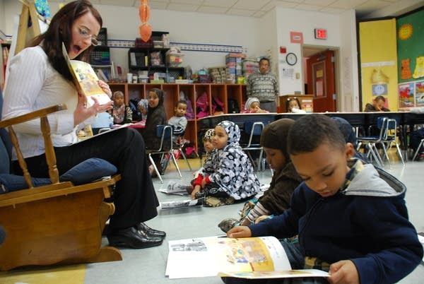 Kindergartners reading with their teacher