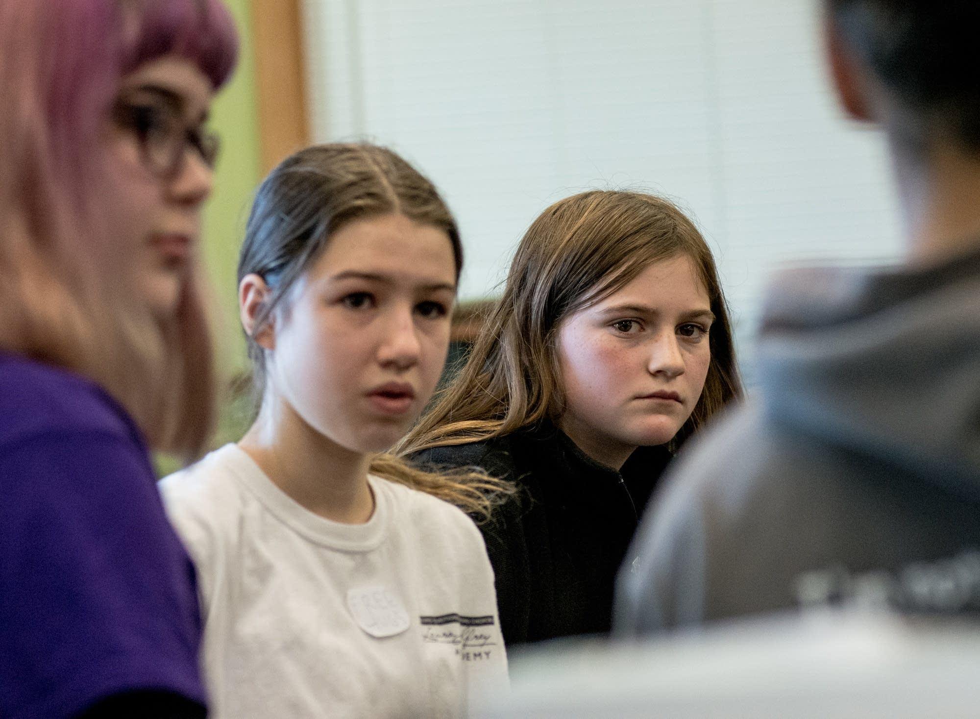 Clara Martin, 11, right