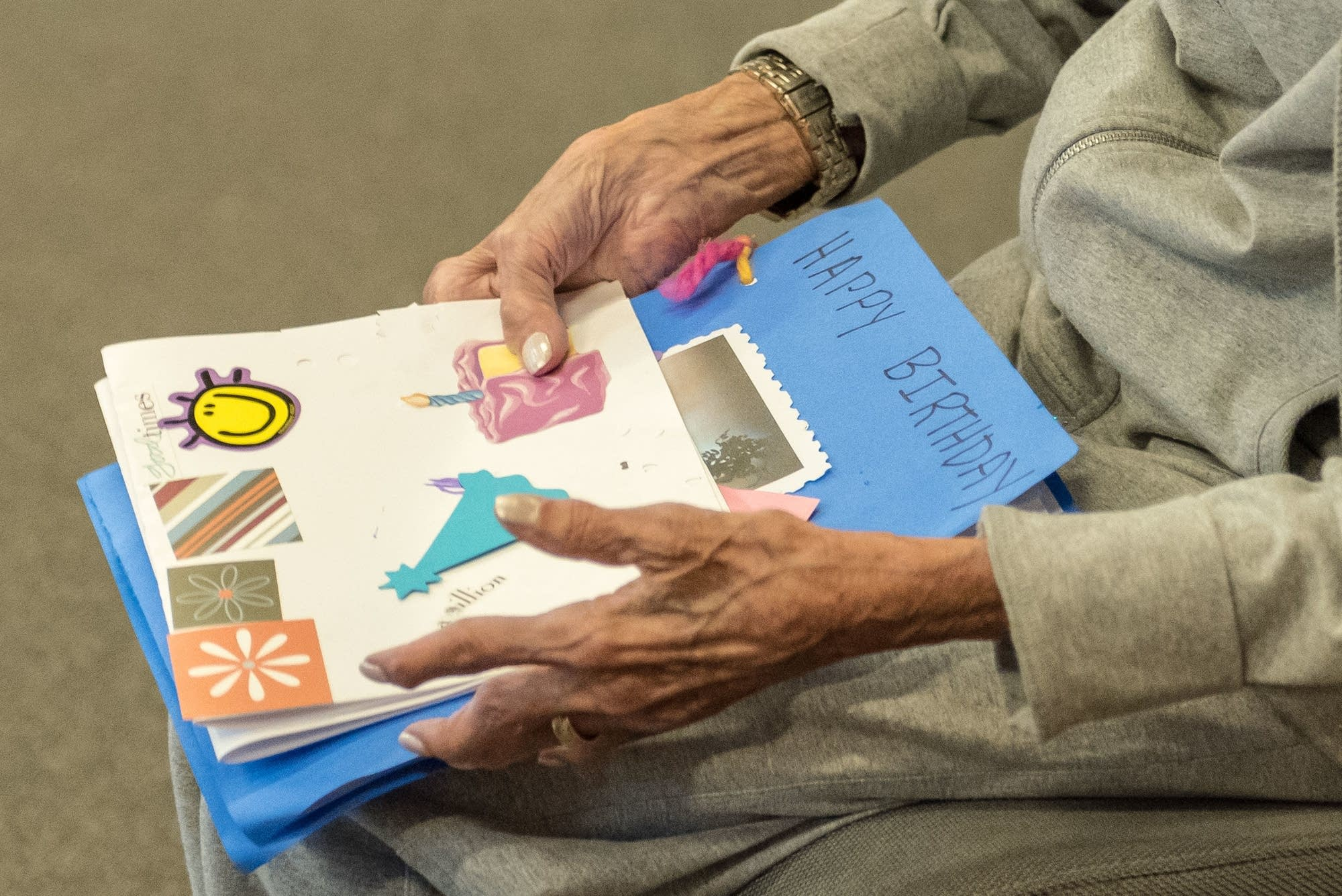 Ruth Knelman holds birthday cards made by pre-K students at Temple Israel.