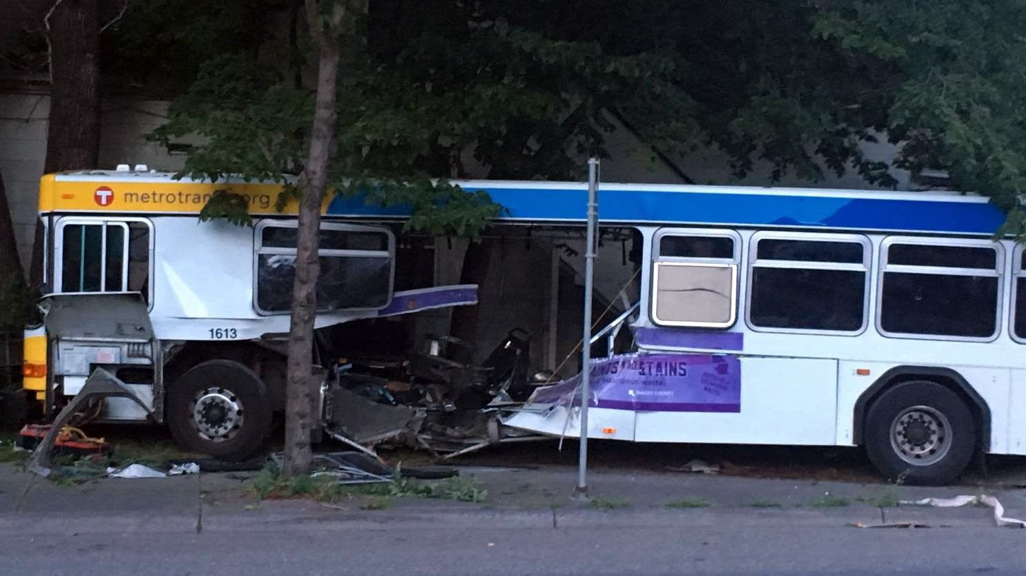 The Route 65 Metro Transit bus after a car ran through it.