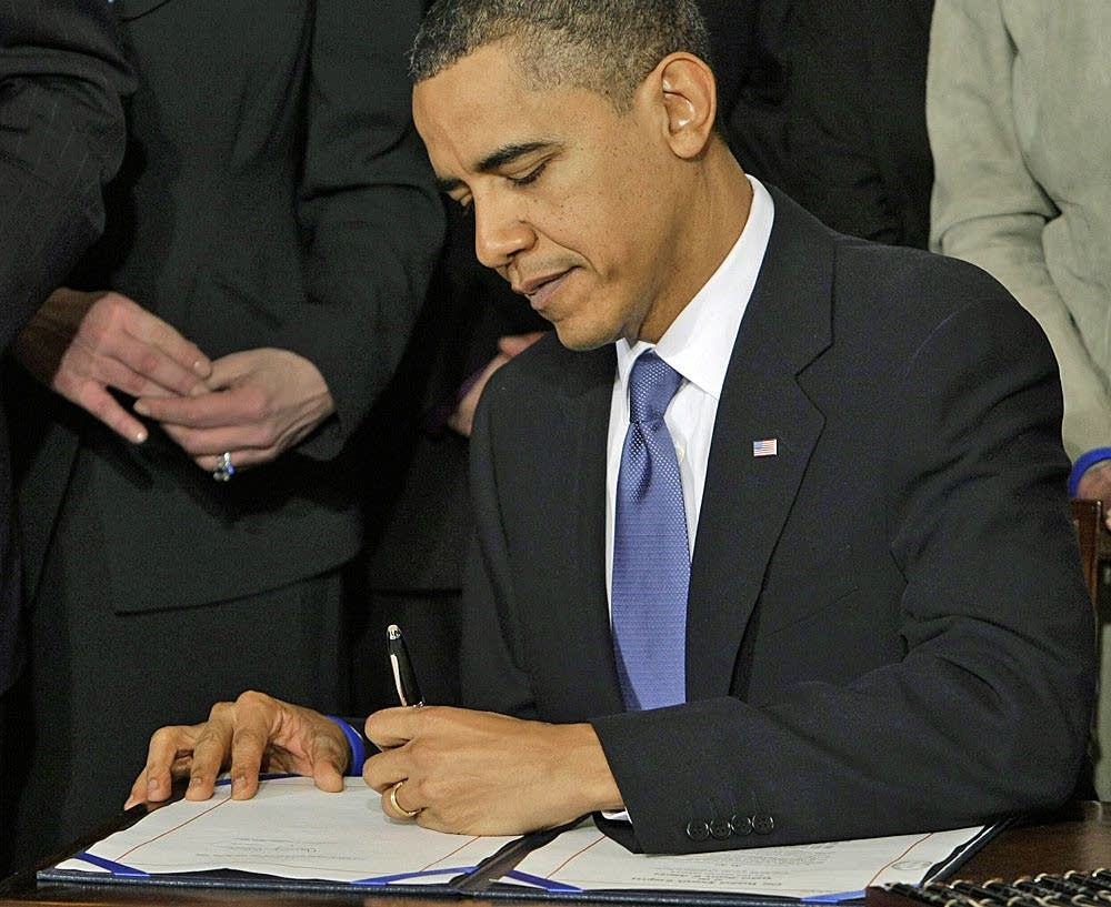Obama signs health care reform