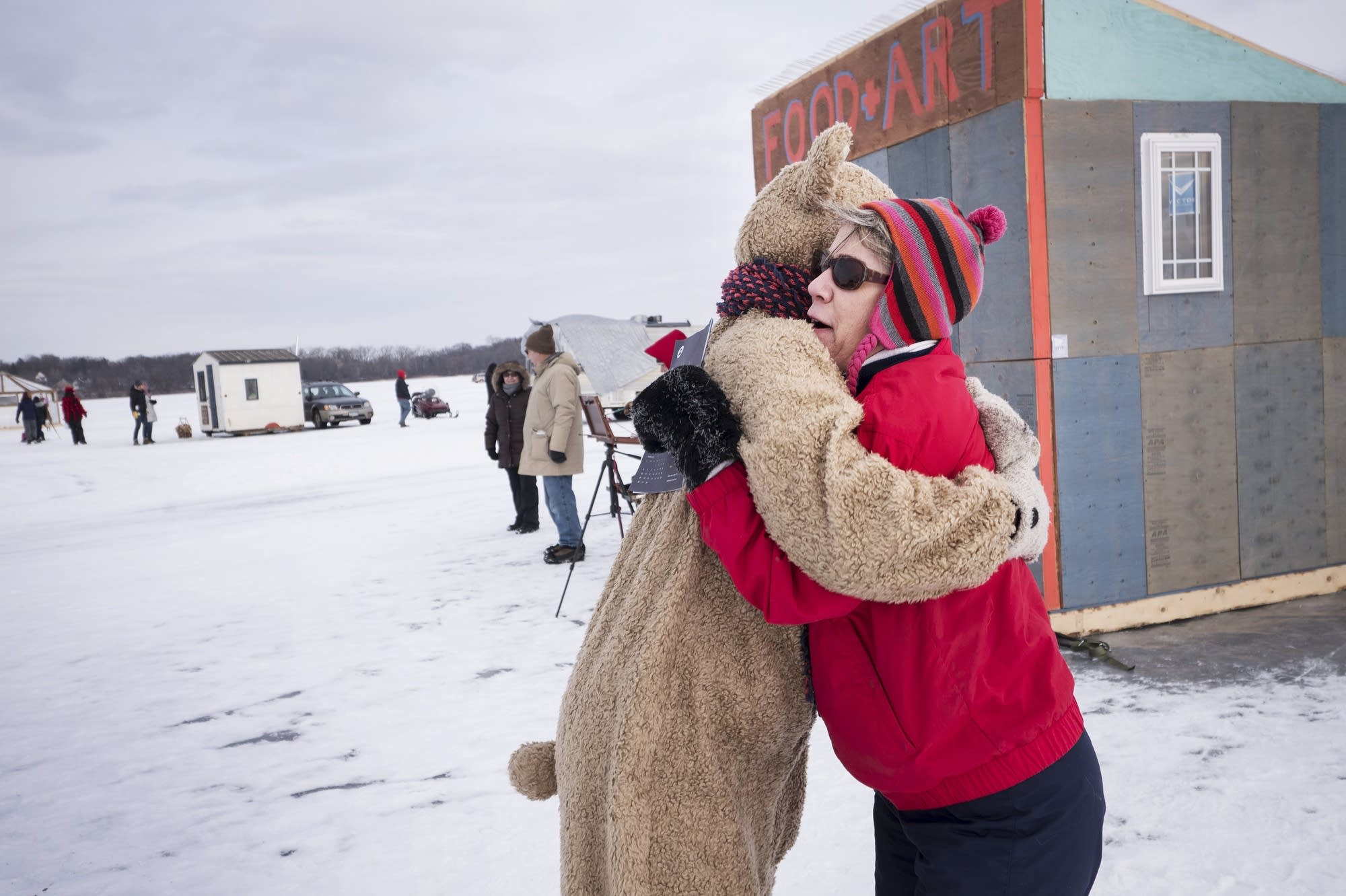 Terry Egge, right, receives a bear hug from Tami Bear.