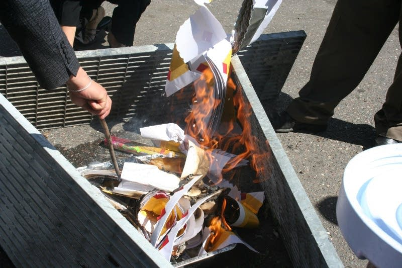 Burning paper money