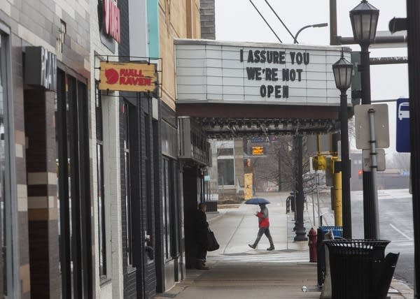 "A movie marquee reads ""I assure you we're not open."""