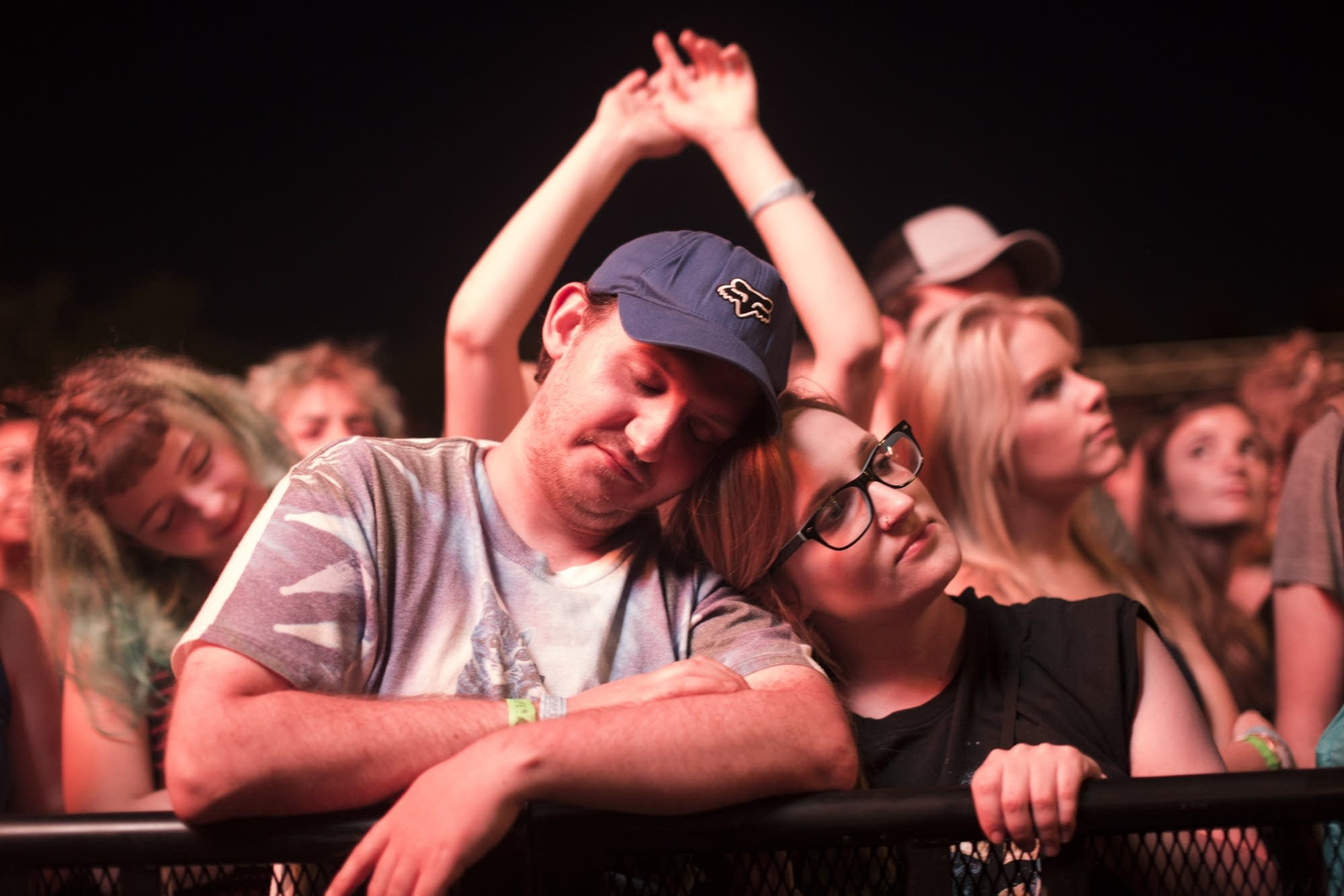 Fans share a quiet moment during Bon Iver's set.