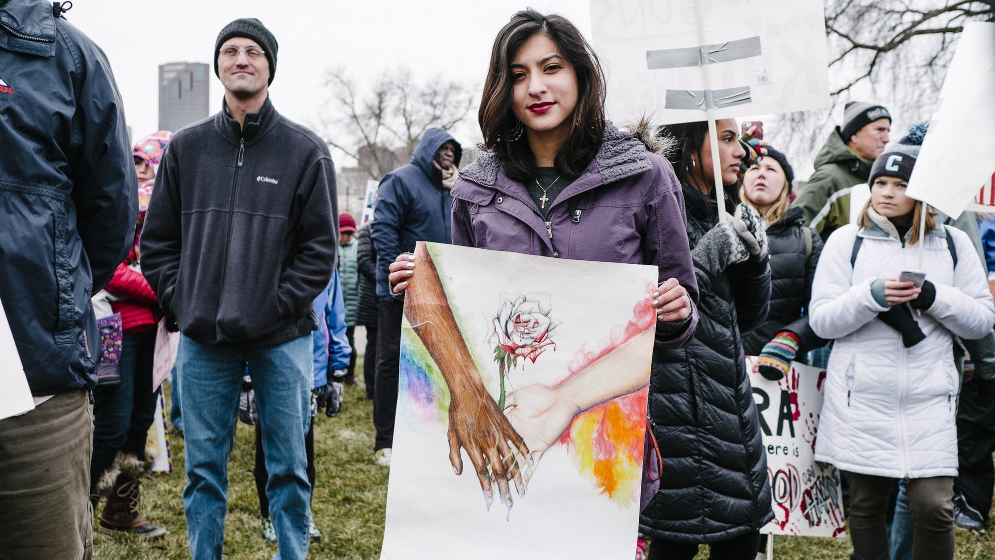 Kimberly Campl holds a drawing she made.