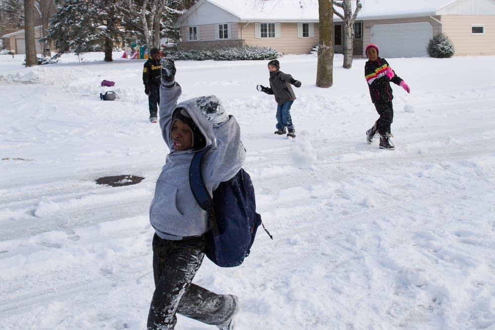 Kids have a snowball fight.