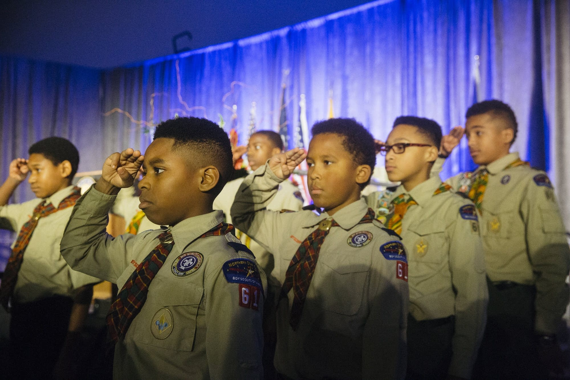 Members of Boy Scout Troop 61 salute