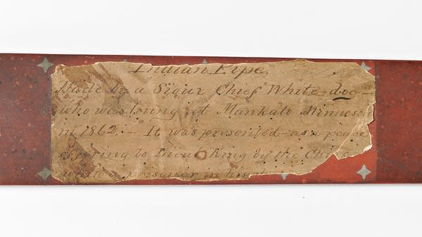 An old paper label reads 'Indian pipe, Made by a Sioux Chief White Dog.'