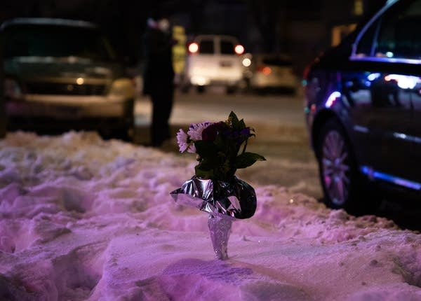 a bouquet of flowers stands up in the snow