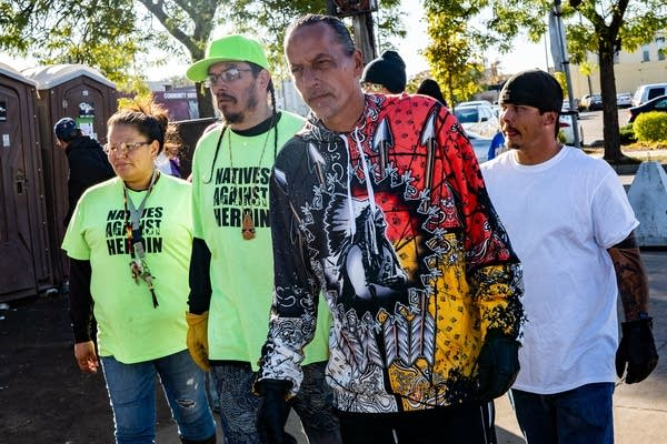 Natives Against Heroin members patrol a homeless encampment in Minneapolis.