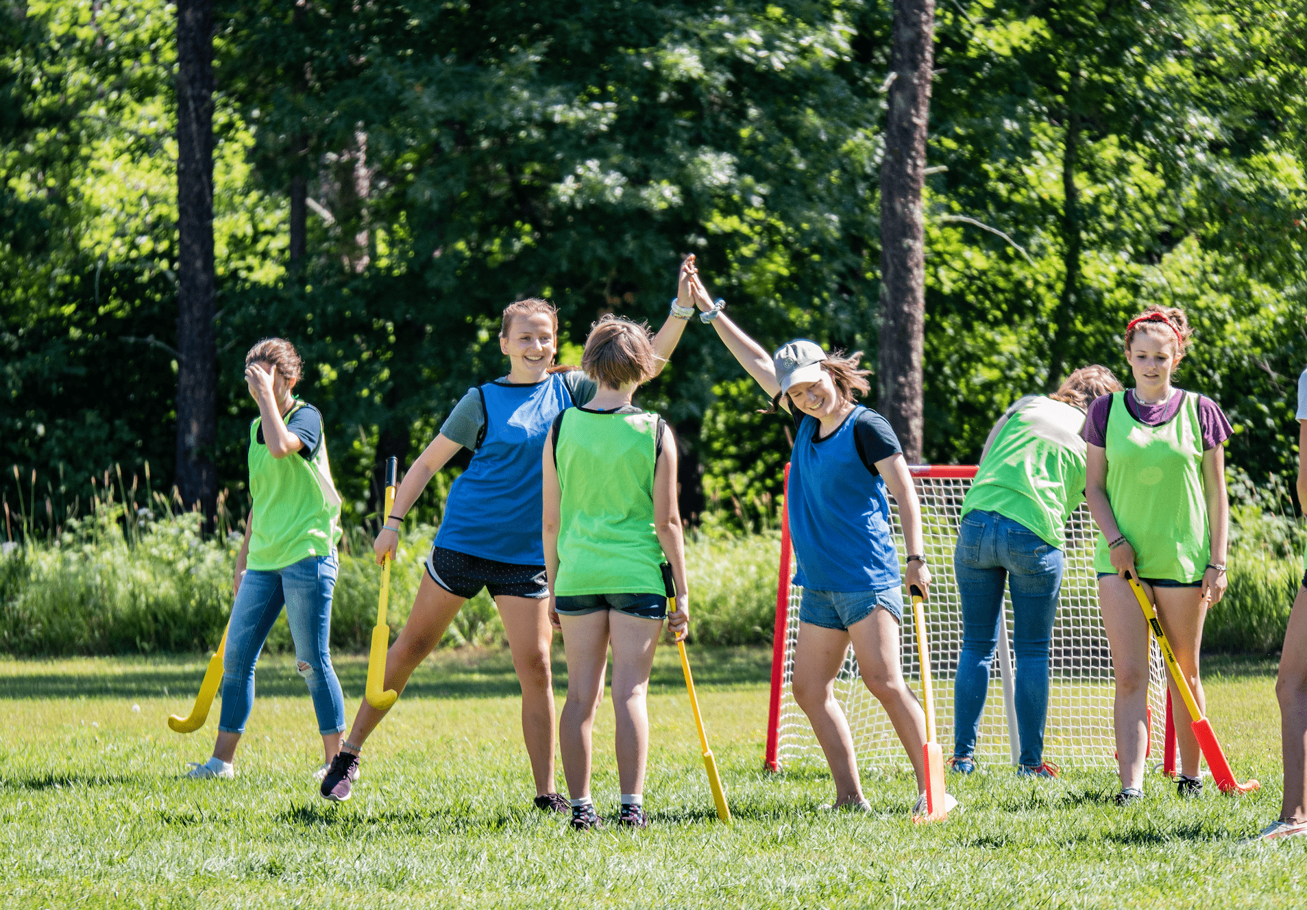 Villagers enjoy a bit of victory during a field hockey game.